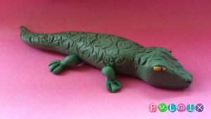 Крокодил на черном фоне. для детей 026