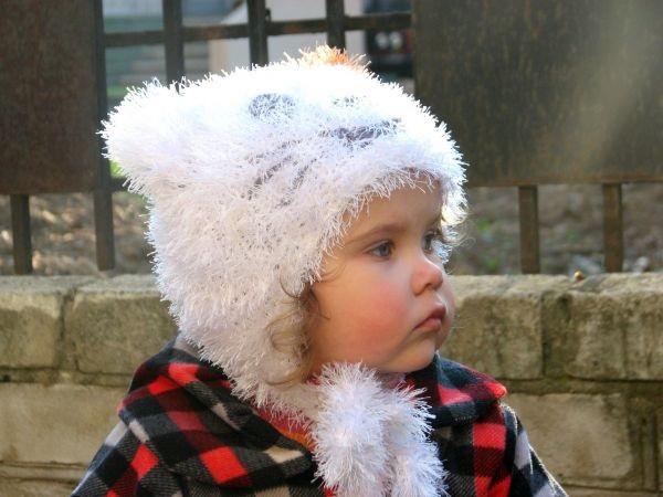 детская шапочка спицами из травки 012